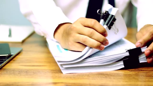businessmen are searching for documents lying on the table,business report papers,important documents. - sistema legale video stock e b–roll