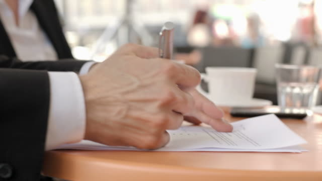 HD: Businessmen Closing Deal In The Sidewalk Cafe video