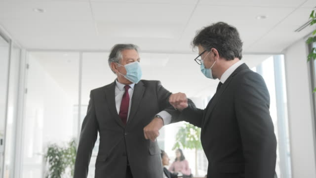Businessmen Greeting with Elbow Bump During COVID-19 video