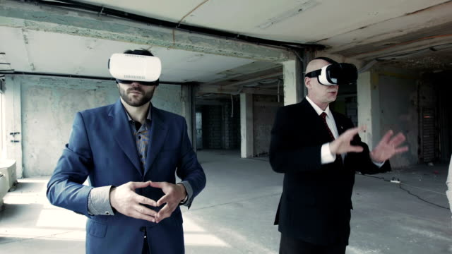 Businessmen in oculus rift using 360 degree interface video