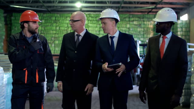 Businessmen meeting in the warehouse video
