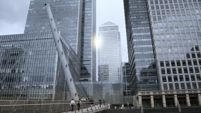 businessmen, people walking on South Quay Footbridge, Canary Wharf, London UK businessmen, people walking on South Quay Footbridge, Canary Wharf, London UK office park stock videos & royalty-free footage