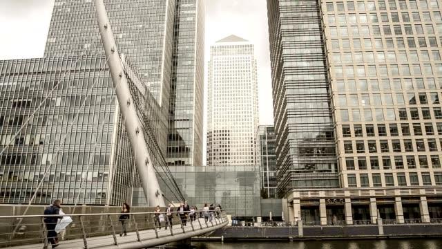 businessmen, people walking on South Quay Footbridge, Canary Wharf, London UK video