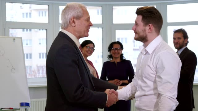 Businessmen shakes hands at the office video