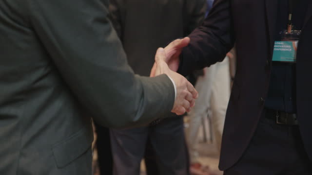 Businessmen shaking hands in business conference