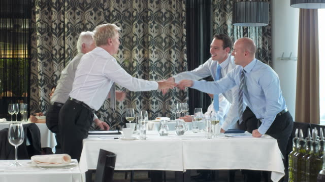 HD DOLLY: Businessmen Signing Papers Over Glass Of Wine video