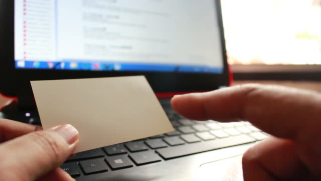 businessmen using notebook for on line shopping with business cards in blurred focus video