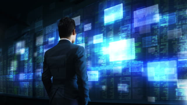 vidéos et rushes de hommes d'affaires avec l'analyse des valeurs mobilières. - book
