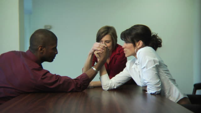 Businesspeople arm wrestling video