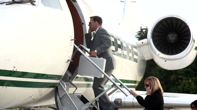 Businesspeople board corporate jet  private airplane stock videos & royalty-free footage
