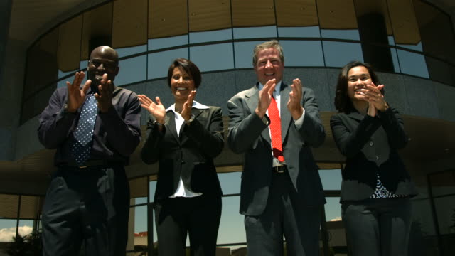 Businesspeople clapping, slow motion video