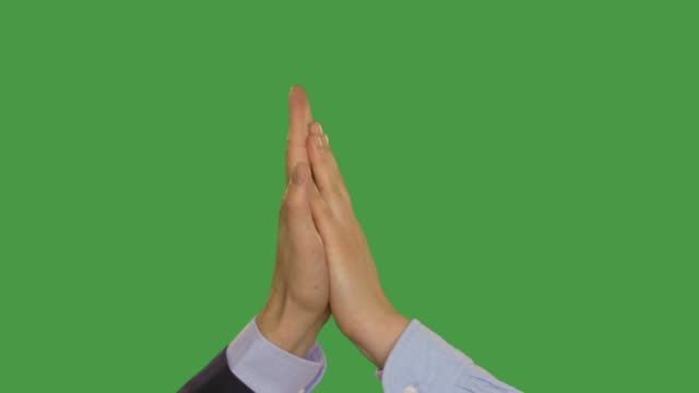 Businesspeople giving high five, keyed green screen