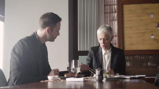 Businesspeople Having Meeting and Lunch In A Restaurant. video