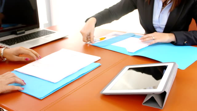 businesspeople in office: agreement sign video
