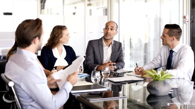 Businesspeople working in meeting video