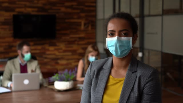 businesspeople working with face masks in the office during covid-19 pandemic - businessman covid mask video stock e b–roll
