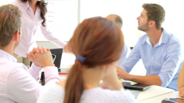 Businesswoman Addressing Meeting Around Boardroom Table video