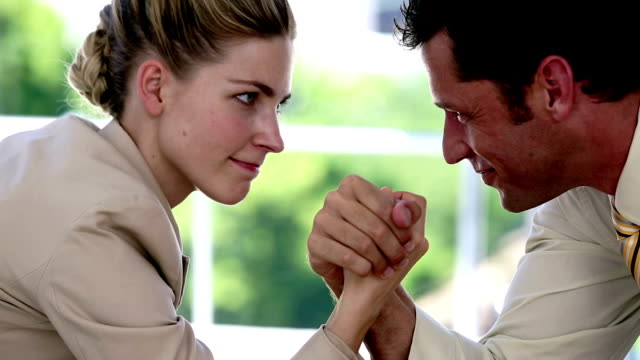 businesswoman and businessman arm wrestling - wrestling stock videos and b-roll footage