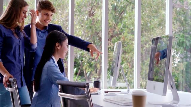 Businesswoman and businessman having conversation in modern office.