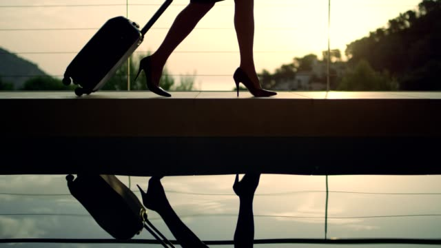 businesswoman arriving to a luxurious spa hotel - high heels stock videos & royalty-free footage