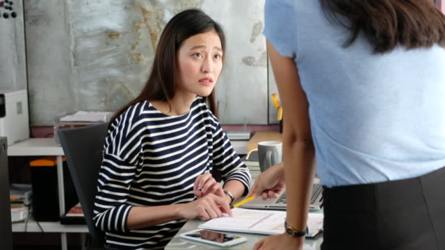 Businesswoman boss complain employee sitting at desk in office video