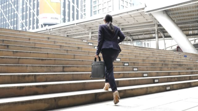 businesswoman commuting to work - business suit stock videos & royalty-free footage
