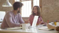 istock Businesswoman discussing with colleague at desk 880429172