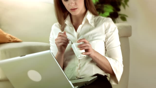 HD: Businesswoman Eating Yogurt video