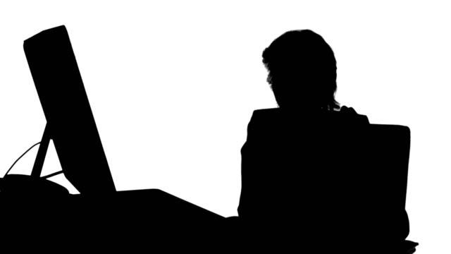 businesswoman filing nails at desk silhouette - blazer bildbanksvideor och videomaterial från bakom kulisserna