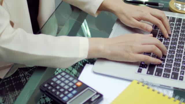 Businesswoman hands typing on laptop keyboard video