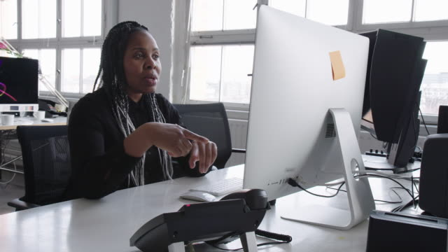 Businesswoman having a video conference over a desktop
