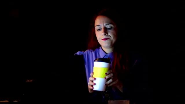 Businesswoman Having Coffee Break in Dark Office video