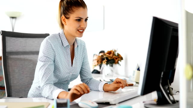 businesswoman in front of computer in the office - manager stock videos and b-roll footage