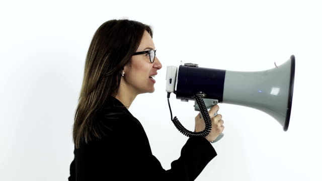 businesswoman in glasses shouting through megaphone. Beautiful businesswoman in glasses shouting through megaphone. megaphone stock videos & royalty-free footage