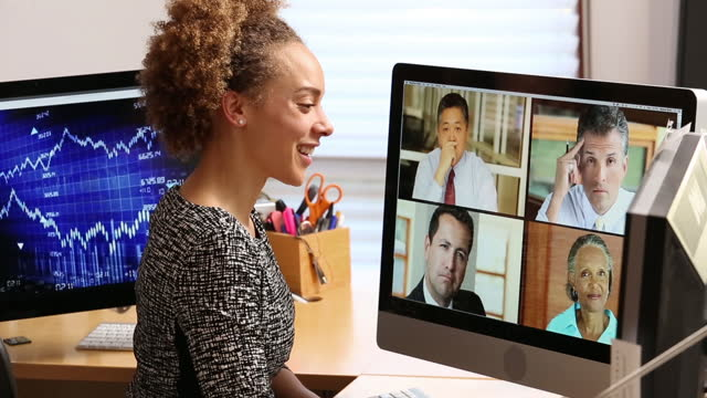 businesswoman in office having a video conference  colleague stock videos & royalty-free footage