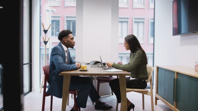 Businesswoman Interviewing Male Job Candidate In Meeting Room Businesswoman interviewing male job candidate in office meeting room job interview stock videos & royalty-free footage
