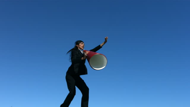 Businesswoman jumping in air with megaphone, slow motion  megaphone stock videos & royalty-free footage