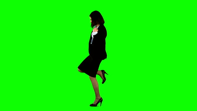 Businesswoman kicking and pointing on green screen Businesswoman kicking and pointing on green screen in slow motion kicking stock videos & royalty-free footage