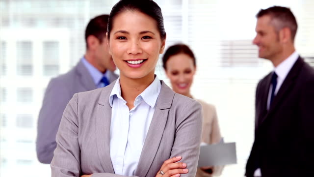 Businesswoman laughing and looking at camera video