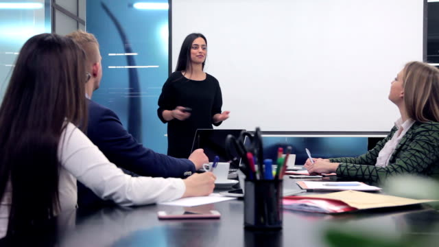 Businesswoman leading a meeting video