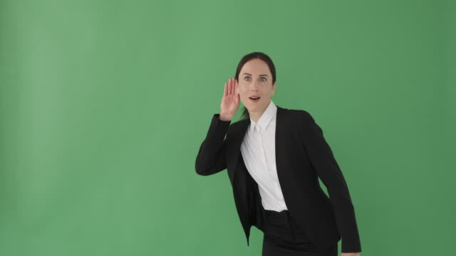 Businesswoman listening secret