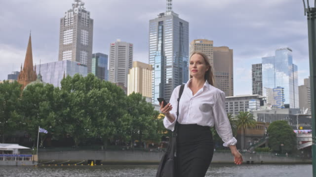 businesswoman looking for directions in the city on mobile phone - melbourne stock videos & royalty-free footage