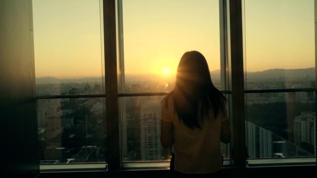 Businesswoman looking sunset video