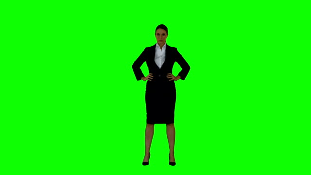 Businesswoman looking to the camera Businesswoman looking to the camera on green screen background arms akimbo stock videos & royalty-free footage