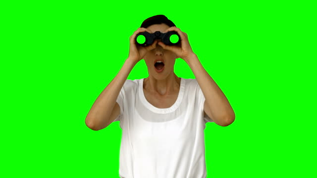Businesswoman looking with binoculars video
