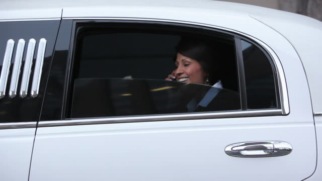 Businesswoman looks out window of limo  luxury car stock videos & royalty-free footage