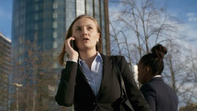businesswoman making call - call center стоковые видео и кадры b-roll