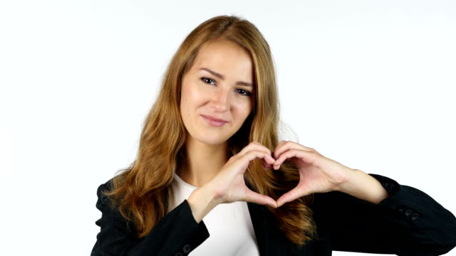 businesswoman making heart with hands , peace ,white background - bassino video stock e b–roll