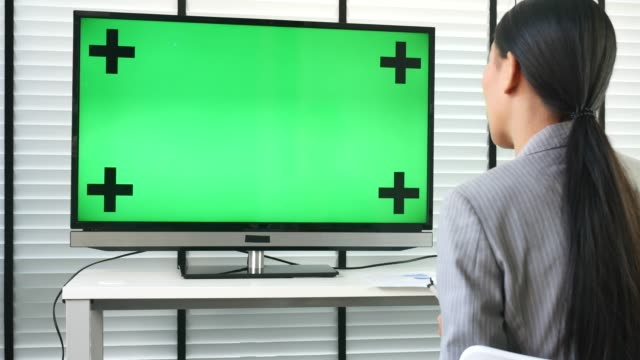 Businesswoman Meeting video Conference with Green screen on Monitor