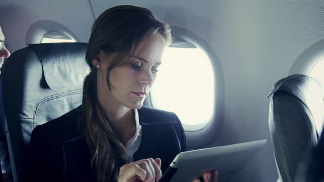 businesswoman on plane - business travel stock videos and b-roll footage